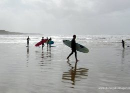Cliff Lodge Rossnowlagh - surfers along beach at Rossnowlagh